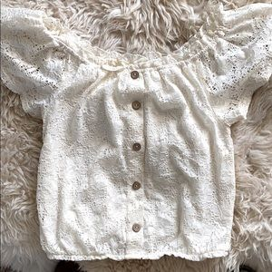 Over the shoulder lacy white top with buttons